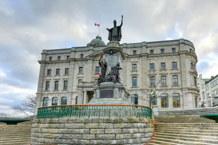 Francois de Laval Monument, the first Roman Catholic bishop of Quebec besides the Old Post Office of Quebec City, Canada.