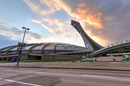 inclined: The Montreal Olympic Stadium and tower at sunset. Its the tallest inclined tower in the world.Tour Olympique stands 175 meters tall and at a 45-degree angle. Editorial