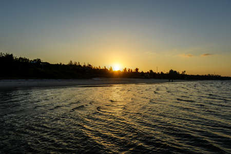 high tide: Panoramic View of Vilanculos Beach in Mozambique during high tide at sunset. Stock Photo