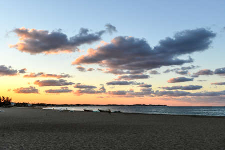 cloud drift: Tofo Beach at sunset in Mozambique. Tofo Beach is the dive capital of Mozambique. Stock Photo