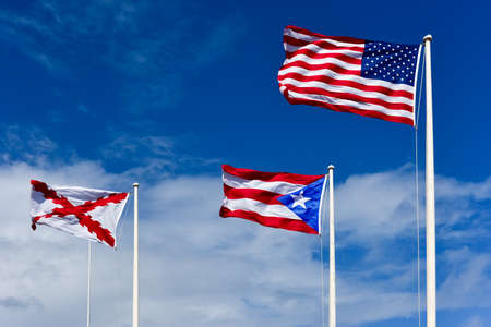puerto rican: The United States, Puerto Rican, and Cross of Burgundy flags atop El Morro Fortress in San Juan, Puerto Rico.