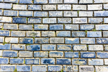 ballast: Blue cobblestone paved street in Old San Juan, Puerto Rico. They were brought as ballast in the bottoms of European merchant ships in the 1700s. Stock Photo
