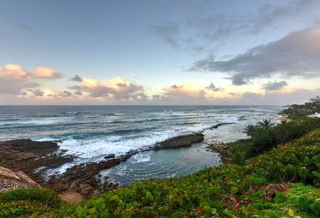 san juan: Playa Pena (Pena Beach) in San Juan, Puerto Rico at sunset.