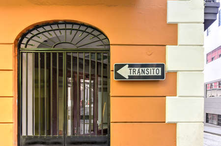transit: Transit sign in Spanish along the classical colonial style architecture of Old San Juan, Puerto Rico.