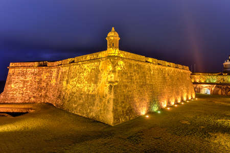 the sentinel: Castillo San Felipe del Morro also known as Fort San Felipe del Morro or Morro Castle at dusk. It is a 16th-century citadel located in San Juan, Puerto Rico.