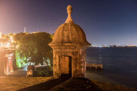 Lookout Tower along the walls of Old San Juan, Puerto Rico from Plaza de la Rogativa with a view of the San Juan Gate.