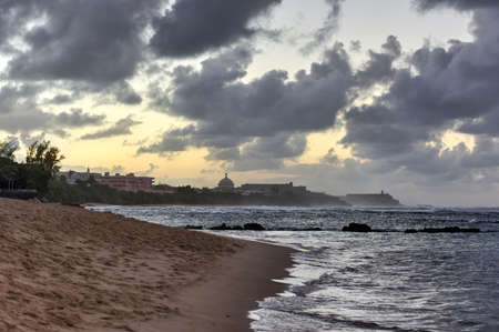 san juan: Beach with waves crossing against the rocks off of San Juan, Puerto Rico.