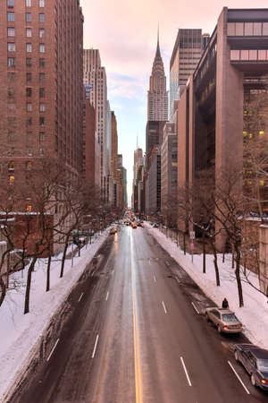 42nd: New York, New York, USA - January 24, 2016: The view looking west down 42nd street in Manhattan from Tudor City in the winter. The Chrysler Building can be seen as well as 42nd street traffic.