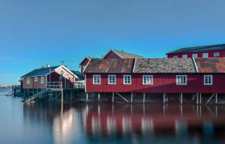 rorbuer: Red fisherman house (Rorbuer) in Winter in Reine, Lofoten Islands, Norway.