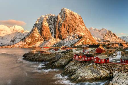 alpine hut: Fishing hut (rorbu) in the Hamnoy and Lilandstinden mountain peak in winter in Reine, Lofoten Islands, Norway.