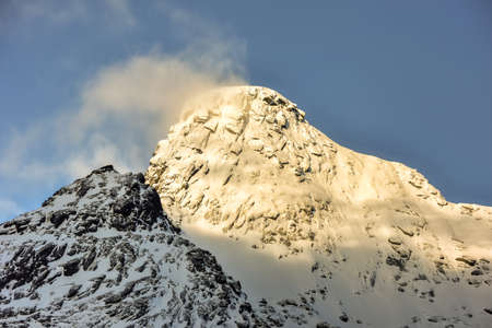 rorbuer: Mountain peaks from the town of Nusfjord in the Lofoten Islands, Norway in the winter. Stock Photo