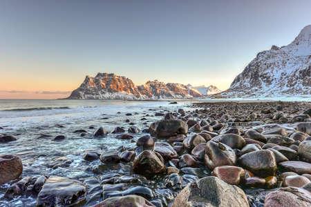 winter sunrise: Dawn at Utakleiv Beach, Lofoten Islands, Norway in the winter.