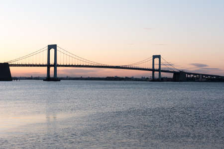 long island: Sunset over Long Island Sound and Throgs Neck Bridge in New York City.