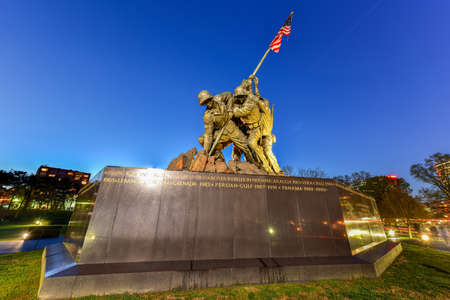 The United States Marine Corps War Memorial depicting the flag raising at Iwo Jima at dusk.