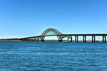 span: The Fire Island Inlet Bridge, an integral part of the Robert Moses Causeway, is a two-lane, steel arch span with a concrete deck that carries the parkway over Fire Island Inlet. Stock Photo