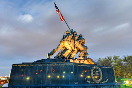 The United States Marine Corps War Memorial depicting the flag raising at Iwo Jima at dusk.