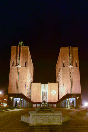 functionalism: Oslo City Hall (Norwegian: Oslo radhus) illuminated at night. It houses the city council, city administration, and art studios and galleries.