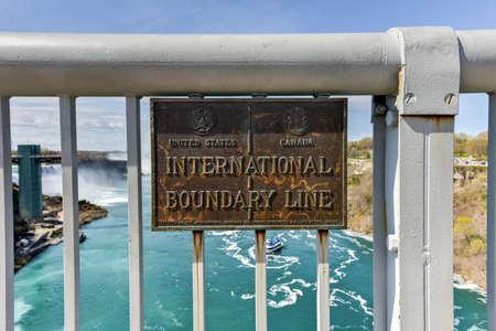 niagara falls city: International Boundary Line between the United States and Canada on the Rainbow Bridge at Niagara Falls.