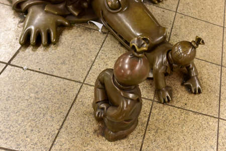 14th: New York - May 19, 2016: Life Underground art installation by Tom Otterness in the 14th Street Eighth Avenue Station in Manhattan, New York.