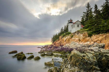 Bass Harbor Head Light in Acadia National Park, Maine at sunset.