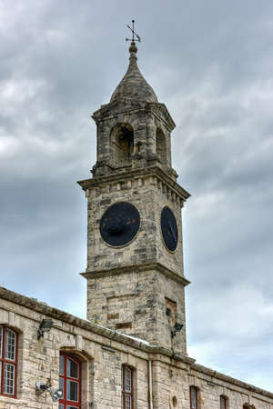 dockyard: Clocktower at the Royal Navy Dockyard, HMD Bermuda which was the principal base of the Royal Navy in the Western Atlantic between American independence and the Cold War. Stock Photo