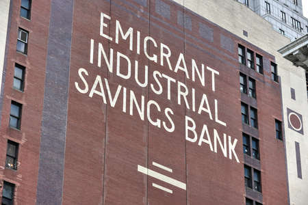 emigrant: New York City - June 29, 2016: Emigrant Industrial Savings Bank Logo painted on the side of a NYC high-rise building.
