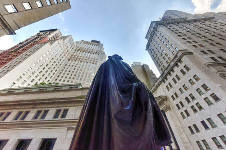 city location: Federal Hall with Washington Statue from behind on Wall Street in Manhattan, New York City. Location where George Washington took the oath of office as first President.