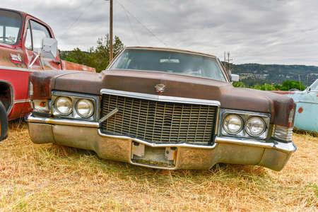 junk yard: Rusting old car in a desert junk yard.