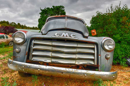 junk yard: Rusting old GMC car in a desert junk yard. Editorial