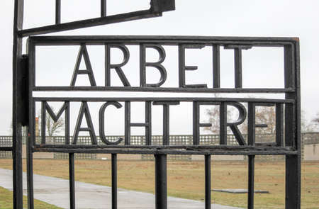 sachsenhausen: Inscription ARBEIT MACHT FREI on the gates to the former Nazi concentration camp, now the Sachsenhausen National Memorial in Oranienburg, Germany.