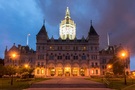 Connecticut State Capitol in Hartford on a summer evening. The building houses the State Senate, the House of Representatives and the office of the Governor.