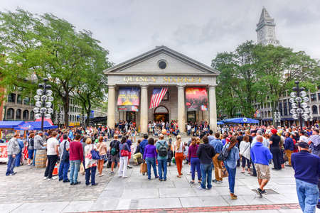 public market: Boston, Massachusetts - September 5, 2016: Crowd of tourists watching a public outdoor show in front of the Quincy Market.