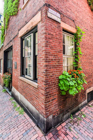 Acorn Street in Boston, Massachusetts. It is a narrow lane paved with cobblestones that was home to coachmen employed by families in Mt. Vernon and Chestnut Street mansions.