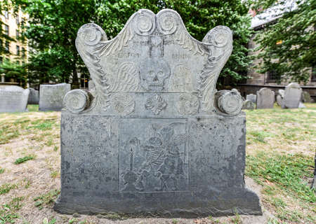 headstone: Detail of an old headstone in the Kings Chapel Burial Ground in Boston, Massachusetts. Stock Photo