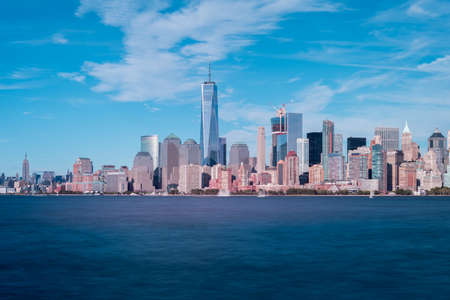 View of the New York City skyline on a summer day.