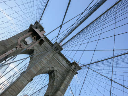 View of the gothic arches of the Brooklyn Bridge.
