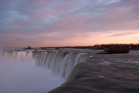 the edge of horseshoe falls: Niagara Falls at sunset from the Canadian side.