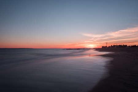 Sunset on Coney Island Beach in Brooklyn, New York. Stock Photo