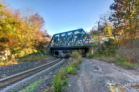 vandalism: Train passing over bridge in Jersey City, New Jersey. Stock Photo