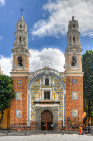 Puebla, Mexico - July 6, 2013: The Sanctuary of Our Lady of Guadalupe presents one of the most representative facades of the so-called Baroque Puebla, characterized by the use of tiles and bricks.