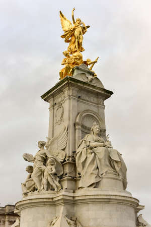 Imperial Memorial to Queen Victoria (1911, designed by Sir Aston Webb) in front of Buckingham Palace in London, UK which was built in honor of Queen Victoria, who reigned for almost 64 years. Editorial