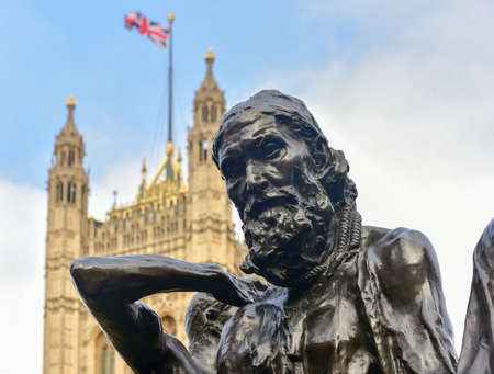 rodin: London, United Kingdom - November 24, 2016: The Burghers of Calais monument by Auguste Rodin close to the Houses of Parliament in Victoria Tower Gardens.