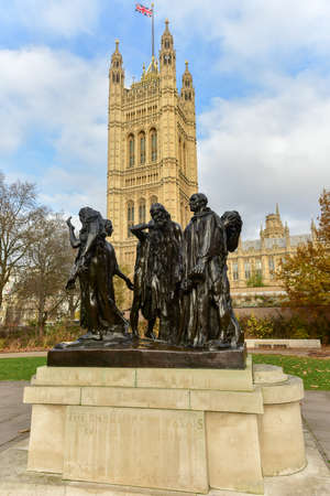 bourgeois: London, United Kingdom - November 24, 2016: The Burghers of Calais monument by Auguste Rodin close to the Houses of Parliament in Victoria Tower Gardens.