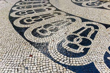 Stone mosaic on the streets of Lisbon, Portugal. Stock fotó