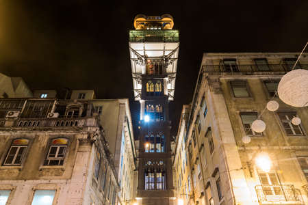 law of portugal: The Santa Justa Lift at night. It is also called the Carmo Lift. It is an elevator, or lift, in the civil parish of Santa Justa, in the historical city of Lisbon, Portugal. Stock Photo