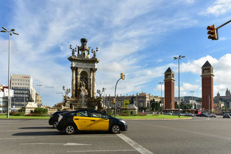 Barcelona, Spain - November 28, 2016: Taxi driving along Placa de Espanya (Square of Spain) in Barcelona, Spain.