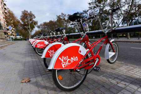 Barcelona, Spain - November 29, 2016: Iconic bicycles of the Bicing service in Barcelona, Spain. With the bicing sharing service people can rent bicycles for short trips.