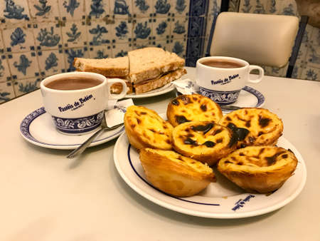 Lisbon, Portugal - November 26, 2016: Pastries of Bethlehem is one of the most famous sweets shop in Lisbon and a touristic destination. Imagens - 71693751
