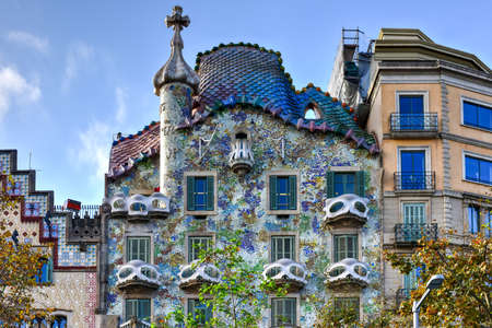 Barcelona, Spain - November 28, 2016: The facade of the house Casa Battlo (also called the house of bones) designed by Antoni Gaudi­ with his famous expressionistic style in Barcelona, Spain.