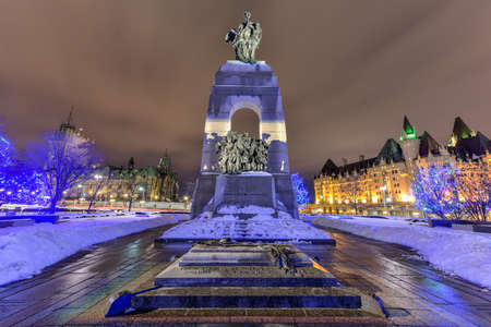 The National War Memorial, is a tall granite cenotaph with acreted bronze sculptures, that stands in Confederation Square in Ottawa, Ontario, Canada.